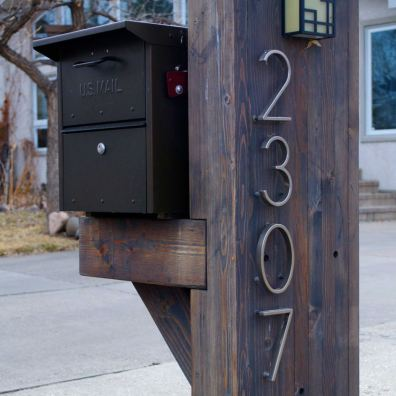 Custom mailbox made of heavy timbers.
