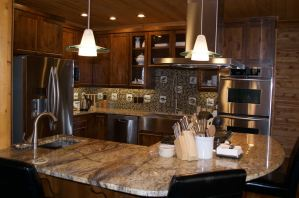 Kitchen with granite, glass tile and designer lighting.