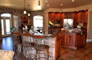 Custom kitchen with elegant stone and granite bar.
