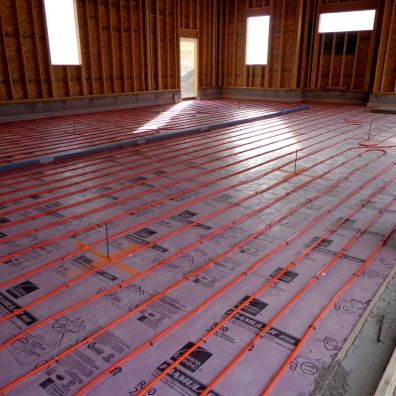 Prep work for in-floor heating and a trench drain.