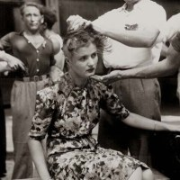 French female collaborator punished by having her head shaved to publicly mark her, 1944