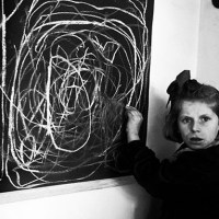 "A girl who grew up in a concentration camp draws a picture of ""home"" while living in a residence for disturbed children, 1948"