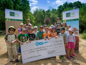 rare Summer ECO Campers help receive Maintenance Assistant Inc.'s gift with officials from both organizations. Photo provided by Maintenance Assistant Inc.