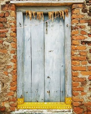 An old house door in the quaint village of Pochampallyhellip