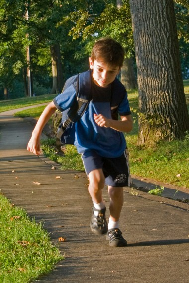 boy, with back pack, running