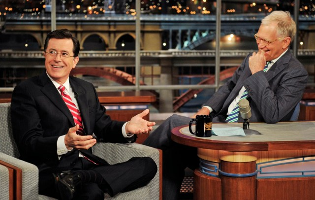 """In this May 3, 2012 photo provided by CBS, Stephen Colbert, left, host of the """"Colbert Report"""" on the Comedy Central Network, has a laugh on stage with host David Letterman on the set of the """"Late Show with David Letterman,"""" in New York. CBS announced on Thursday, April 10, 2014 that Colbert will replace Letterman as """"Late Show"""" host after Letterman retires in 2015. (AP Photo/CBS, John Paul Filo) MANDATORY CREDIT, NO SALES, NO ARCHIVE, FOR NORTH AMERICAN USE ONLY"""