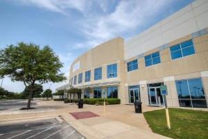 General Motors bought this Austin building from Karlin.