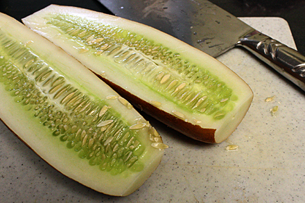 Old cucumber sliced into halves