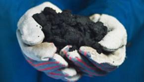 tar-sand-in-hand