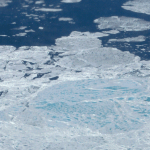 "Aerial photograph showing a section of sea ice. The lighter blue areas are melt ponds and the darkest areas are open water, both have a lower albedo than the white sea ice.  ""Sea Ice MeltPonds"" by United States National Aeronautics and Space Administration (NASA) - http://earthobservatory.nasa.gov/Newsroom/NasaNews/2003/2003100216000.html. Licensed under Public Domain via Wikimedia Commons - http://commons.wikimedia.org/wiki/File:Sea_Ice_MeltPonds.png#mediaviewer/File:Sea_Ice_MeltPonds.png"