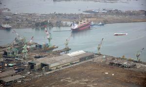 US_Navy_110320-N-OB360-166_An_aerial_view_of_ships_washed_ashore_and_overturned_at_a_port_near_the_Japan_Air_Self-Defense_Force_Matsushima_Air_Base