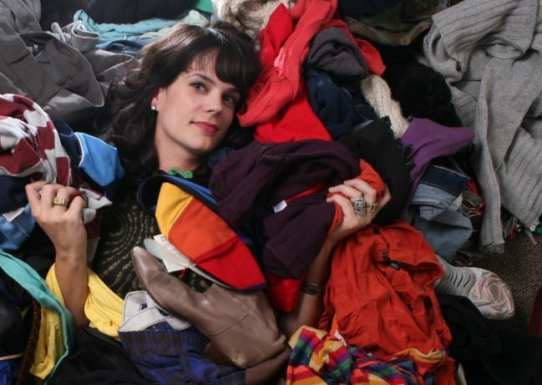 Cline in a closet full of clothes with nothing to wear!