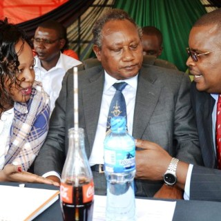 From left; Nyeri nominated MCA Eva Githaiga, Nyeri deputy governor Samuel Wamathai and Nyeri Speaker Mwangi Mugo chat at Whispers Park in Nyeri town recently during the UN International Day for Persons Living With Disabilities. Photo  Robert Nyagah