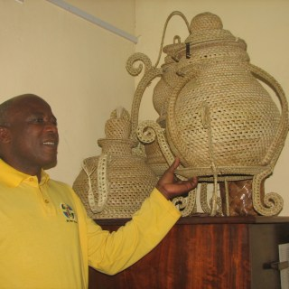 Harrison Baya, the group Secretary explains how their items are made. [ Picture: Halisi Polo ]