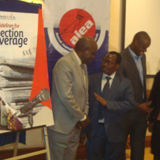 Guest look at the billboard on Elections Reporting Guidelines after it was launched in Nairobi recently. Picture Henry Owino