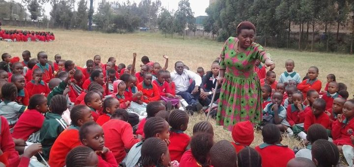 Hannah Wanja spending time with pupils as part of her mentoring activities.She has overcome her disability and stigma to become a role model in the society.Picture:Henry Wahinya