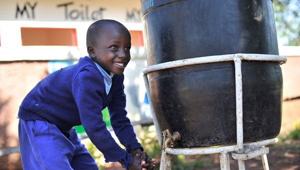 A pupil at Kimangora Primary School in Bomet County washes his hands after visiting the toilet.Kimangora is one of the lucky public primary schools in Kenya to enjoy good sanitation.Picture:Courtesy