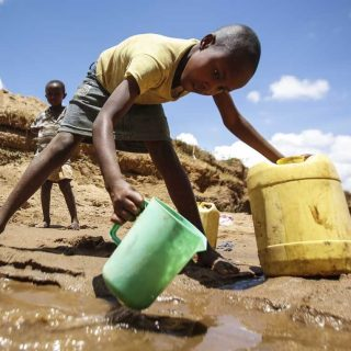 A boy collects water in a dry river bed in Kitui County.This will however be a thing of the past with the construction of an earth dam by United Nations Development Programme (UNDP).Picture:Courtesy
