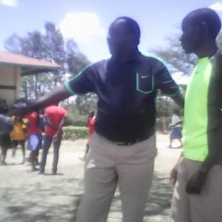 Coach Boniface Tiren guides an athlete in Chewoyet High School. Picuture by Levi Wekoye