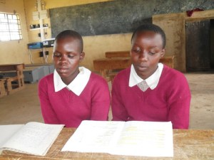 Girls engaging in after school revision which is made possible by the boarding facility. Photo Joyce Chimbi