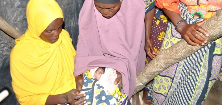 Mariam Mwakombo ( in yellow) with her mother-in-law Chizi Ndune at their home at Mreroni area in Jomvu, Mombasa County. Mwakombo gave birth to a baby girl with a rare condition. Picture: Atieno Akumu