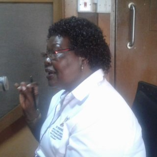 Kisumu County Director for Gender Affairs Mrs. Jane Obiero talking about GBV in Kisumu at a local radio station.Picture:Oliver Ochieng