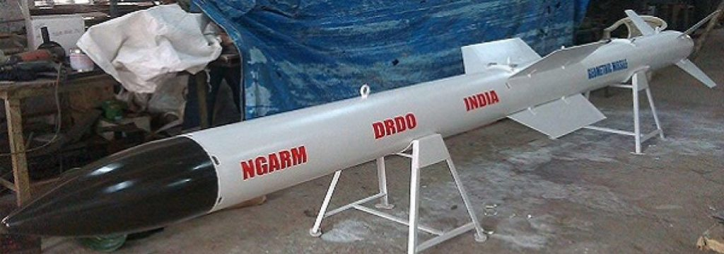 Black and white colored NGARM missile displayed on a stand