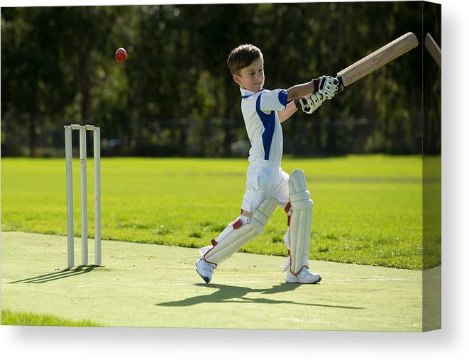 Young Boy Playing Cricket Canvas Print