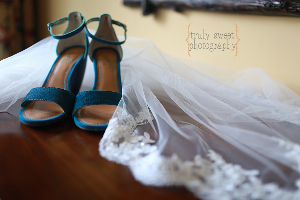 Brides blue wedding shoes with scalloped lace veil