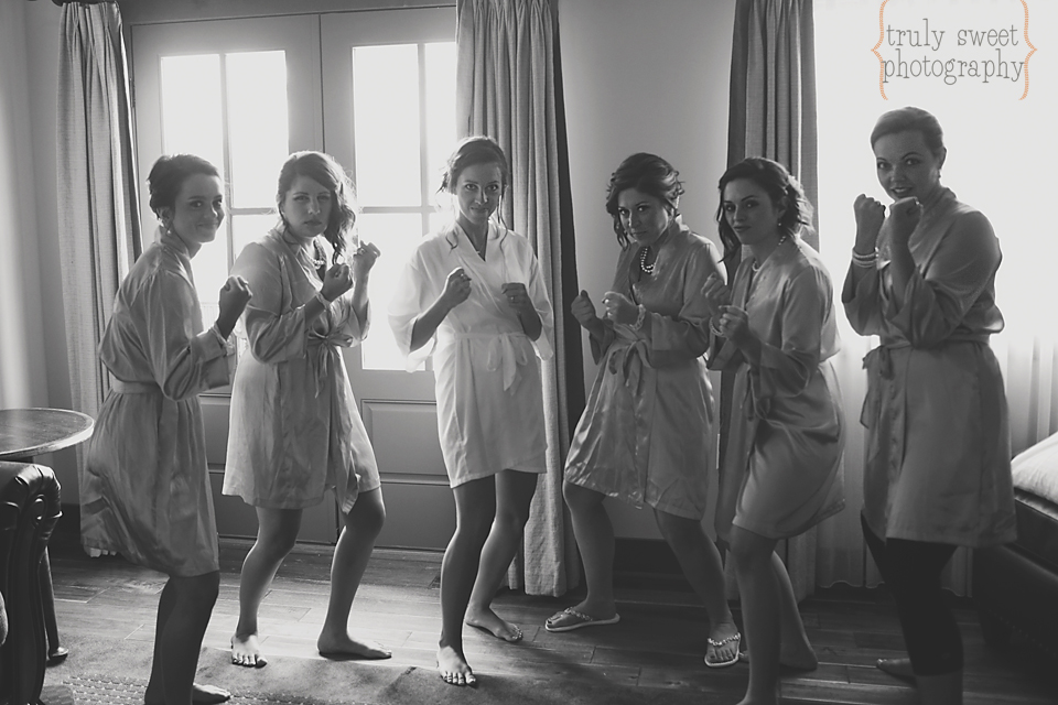 bride and bridesmaids in matching robes boxing silly