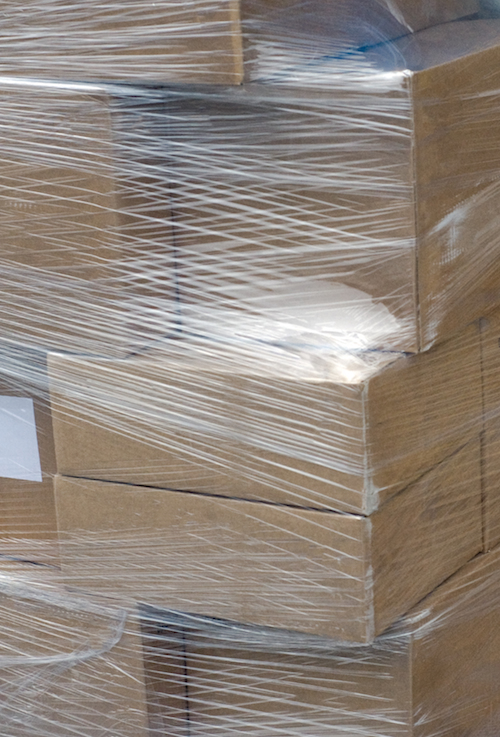 stock-photo-packed-tiles-stack-of-white-wall-covering-tiles-packed-with-blue-transparent-shrink-wrap-in-a-322400324