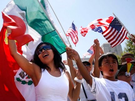 """People march through downtown Los Angeles supporting amnesty for illegal immigrants living in the United States Saturday, Sept. 2, 2006. The event, called """"La Gran Marcha Laboral,"""" was organized by the March 25 Coalition, which put on a massive protest in Los Angeles earlier this year. (AP Photo/Oscar Hidalgo)"""