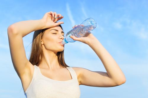woman-drinking-water-after-workout