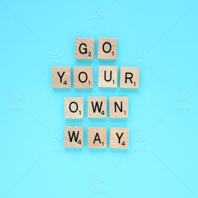 Go your own way! A scrabble tile quote against a turquoise blue