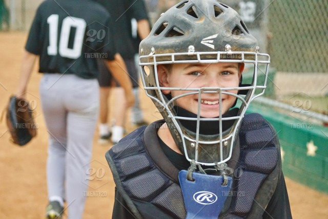 An amazing, happy and awesome kid, smiling after a baseball game