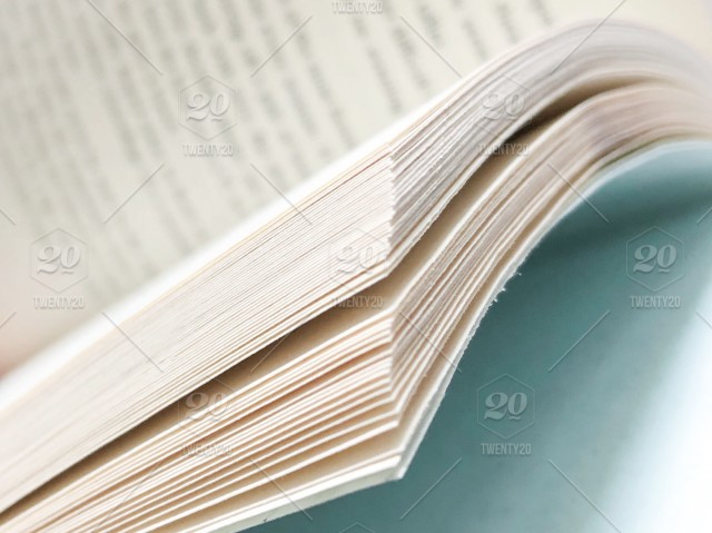 Detail view of open book pages corner with copy space stock photo