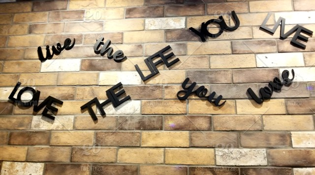 Words in the Wild on a Brick Wall in a Restaurant! Live the life you love
