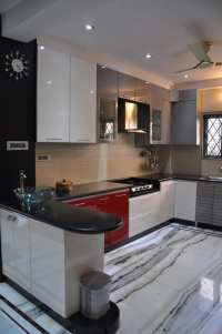 U shaped kitchen with modern cabinets and wall decor by ...