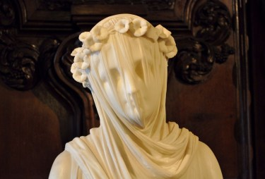 The Vestal Virgin with a see through veil of marble