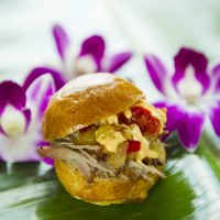 """Guests can sample tapas-sized tastes of inventive cuisine such as the Kalua Pork Slider (not the liqueur Kahlua but the Kalua barbecue method of cooking) at the Hawaii Marketplace during the Epcot International Food & Wine Festival at Walt Disney World Resort in Lake Buena Vista, Fla. The popular fall festival also features wine tastings, culinary demonstrations, mixology seminars, nightly """"Eat to the Beat"""" concerts and a broad range of premium dining events. (Matt Stroshane, photographer)"""