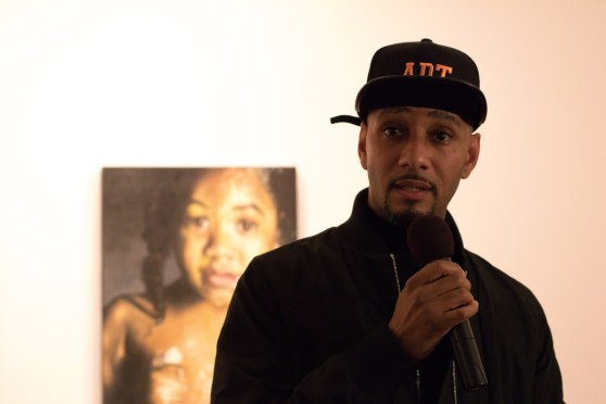Swizz Beatz gives the opening remarks at the Sotheby's auction. (Photo by Nate Eames)