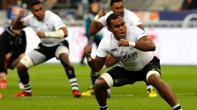 Fijian players perform the Cibi before the test against France.