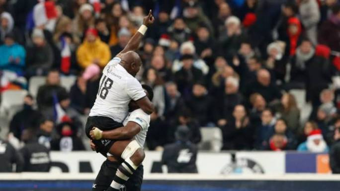 Fijian players are overcome with emotion after a historic first rugby test win over France.
