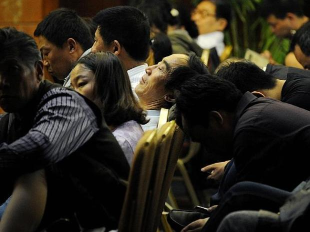 Waiting for news ... Chinese relatives of passengers on the missing Malaysia Airlines fli