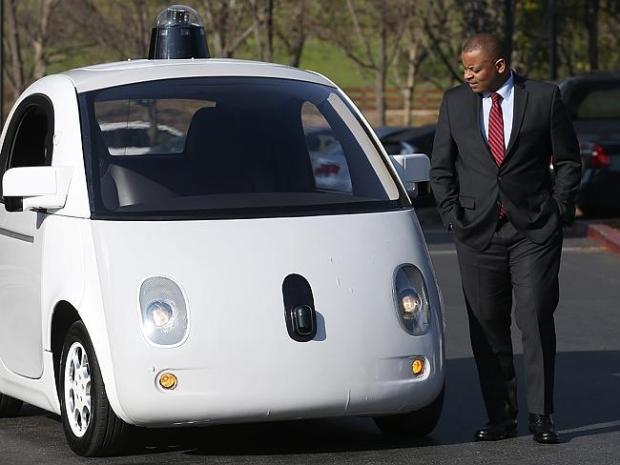 US Transportation Secretary Anthony Foxx inspects a Google self-driving car in California