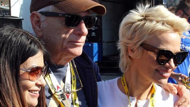 Ordeal ... Pamela Anderson poses with friends at the Talladega Superspeedway earlier this