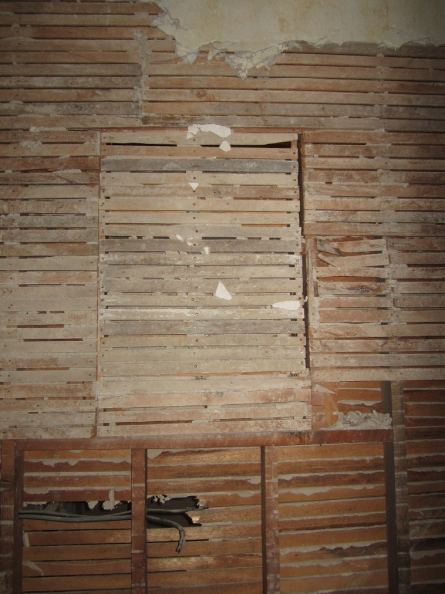 A close-up of the blocked-over 1920s interior window. Obviously, the window would have been frosted or something so that people using the stair could not look into the bathroom.