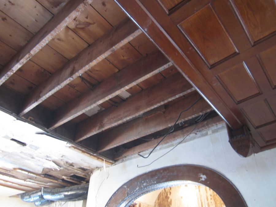 The non-original plaster has now been removed, exposing 2x12 beams last seen when they were installed in the 1920s.