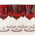 Fabulous set of six ruby red wine glasses with hand applied argento silver overlay decor. Made by Cenedese Glass, Murano Italy in the 1940s'-1950's.
