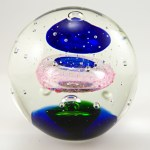 Floating colorful orb paperweight.